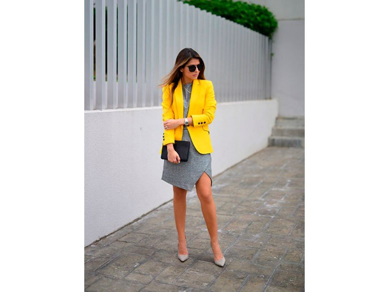With gray dress gray shoes and black clutch